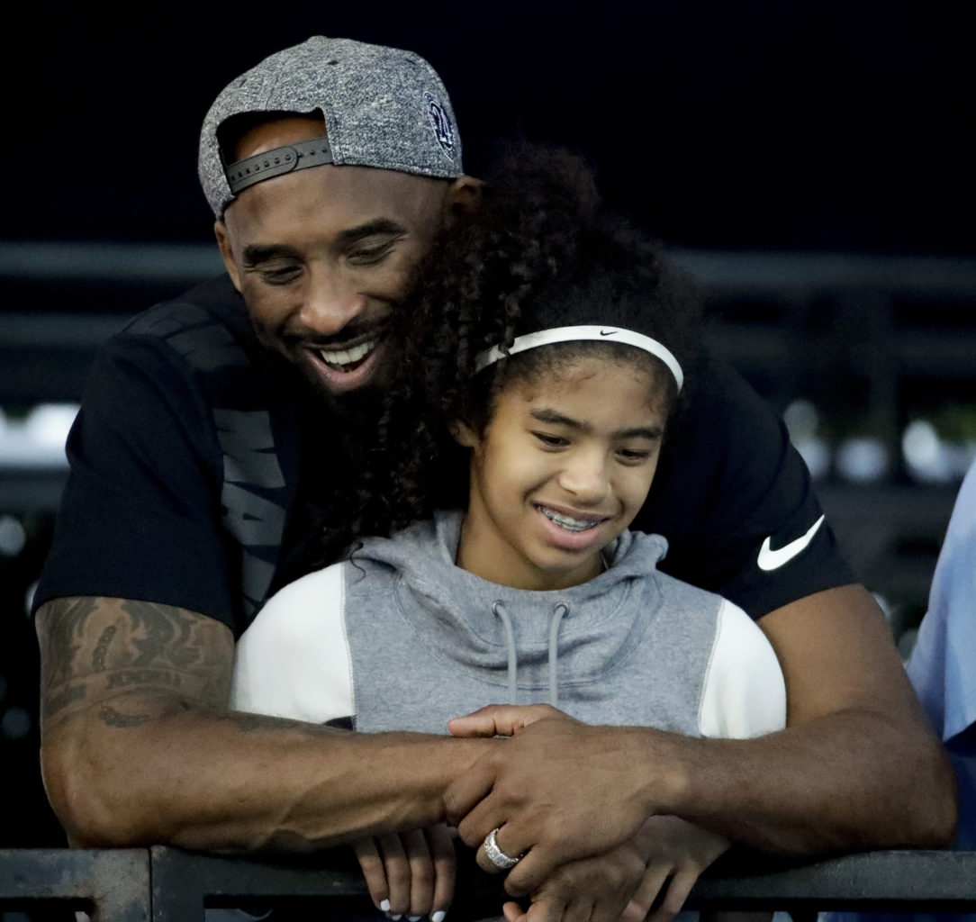 In this July 26, 2018 file photo former Los Angeles Laker Kobe Bryant and his daughter Gianna watch during the U.S. national championships swimming meet in Irvine, Calif. AP photo by Chris Carlson.