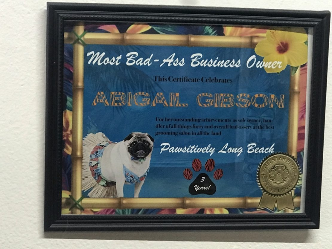 """floral -and-dog-embossed framed certificate that says """"most badass groomer."""""""