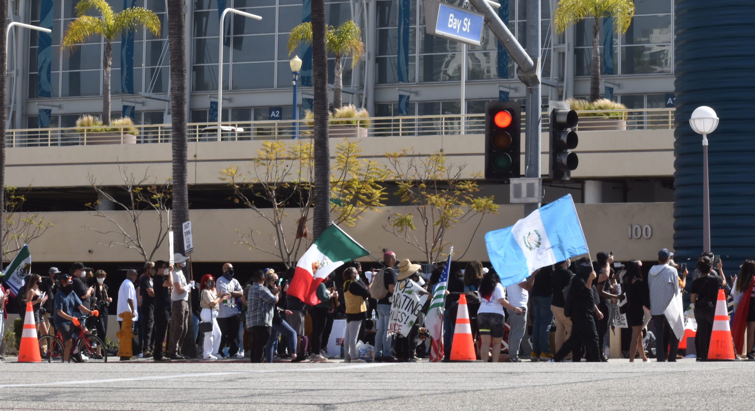 Activists rally Downtown, demanding transparency, access at Long Beach migrant shelter • Long Beach Post News