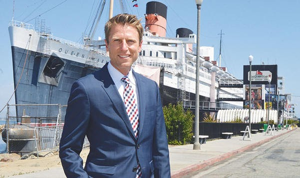 Taylor Woods stands in front of the Queen Mary in September 2017. Photo by Brandon Richardson, Long Beach Business Journal.