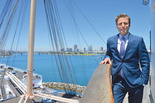On Saturday, August 13, 2016, Taylor Woods, pictured aboard the Queen Mary, and Urban Commons co-founder Howard Wu celebrated the company's 66-year master lease with a Changing of the Guard event in the ship's Grand Salon. Photo by Larry Duncan, Long Beach Business Journal.